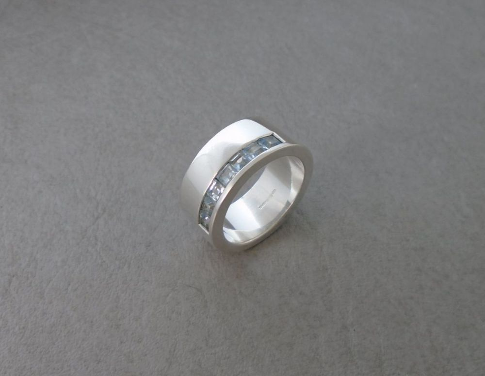 Solid thick set sterling silver & topaz ring