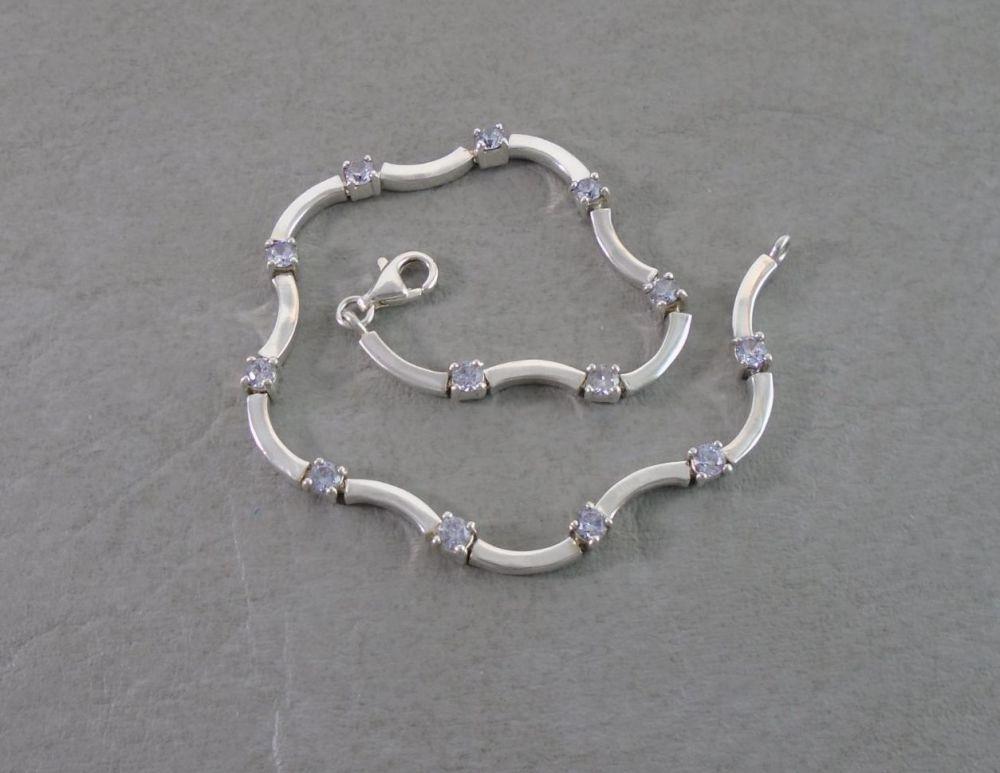 Wavy sterling silver & clear stone tennis bracelet