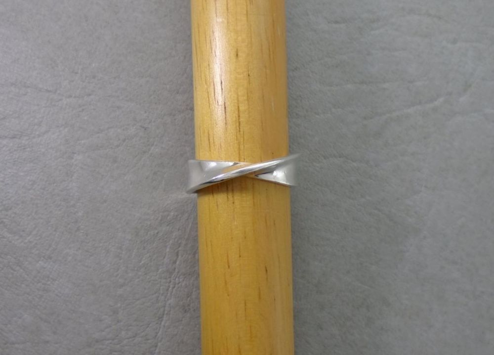 Simple solid sterling silver twist ring