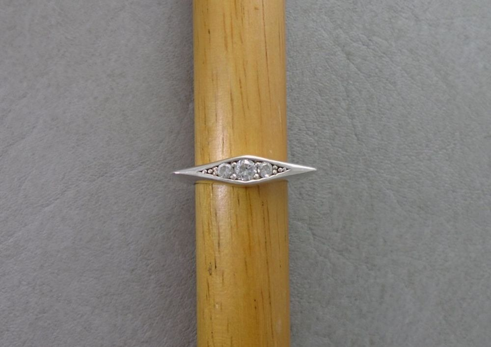 Unusual sterling silver tri-stone ring with triangular shoulders