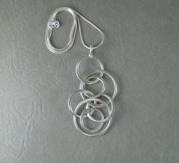 Sterling silver necklace with a long interlinked circles pendant