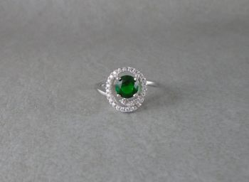 Sterling silver ring with a swirl accented green stone