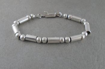 Heavy sterling silver tube & sphere bracelet