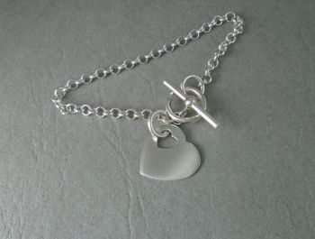 Sterling silver toggle bracelet with a heart tag / charm