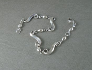 Sterling silver scroll & bead bracelet with shimmer detail