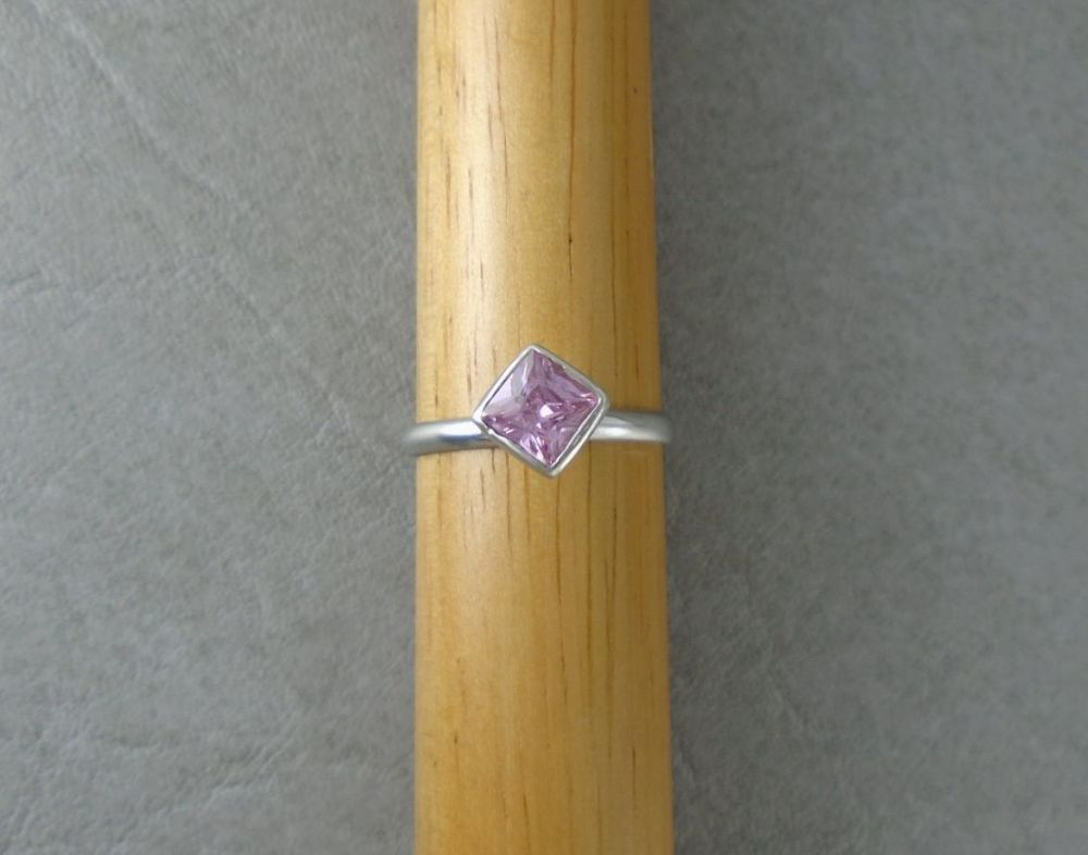 Off-set sterling silver & pink square solitaire ring