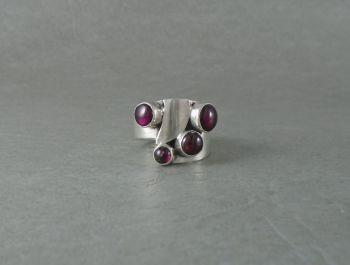 Handmade asymmetric sterling silver & garnet ring