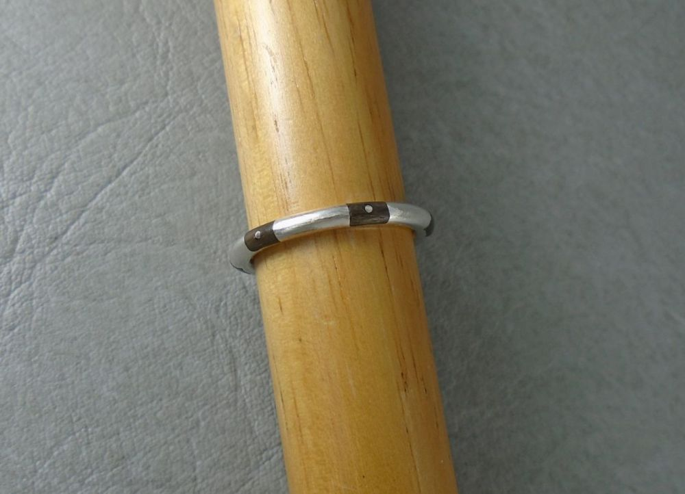 Unusual sterling silver ring with wooden inlay