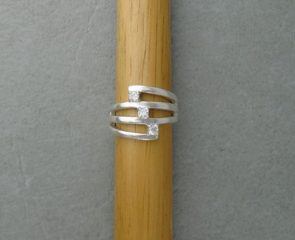 Sterling silver tri-band effect ring with clear stones