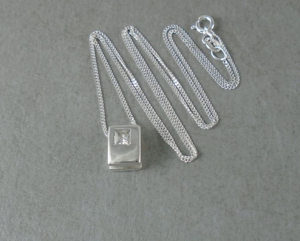 Sterling silver necklace with a small stone set rectangular pendant