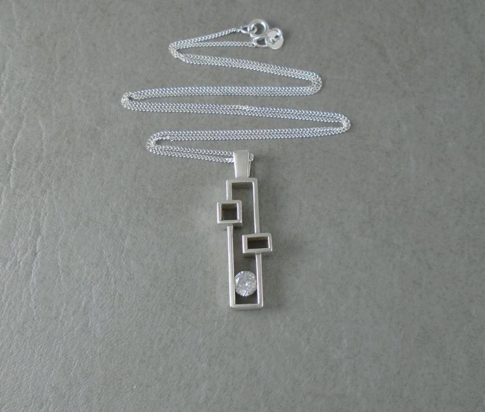 Sterling silver abstract shadow box necklace