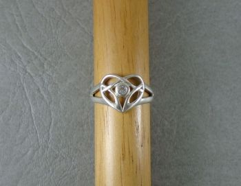 Fancy sterling silver heart ring with a clear stone