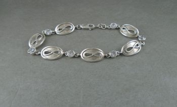 Sterling silver bracelet with infinity oval panels & clear stones
