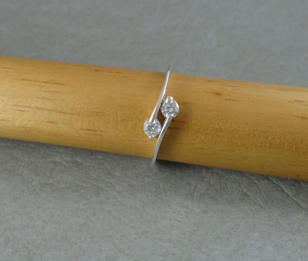 Slim sterling silver clear stone bypass ring