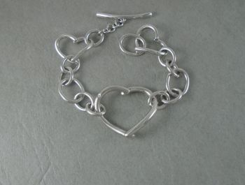 Chunky sterling silver & diamond toggle bracelet with graduated hearts & ovals