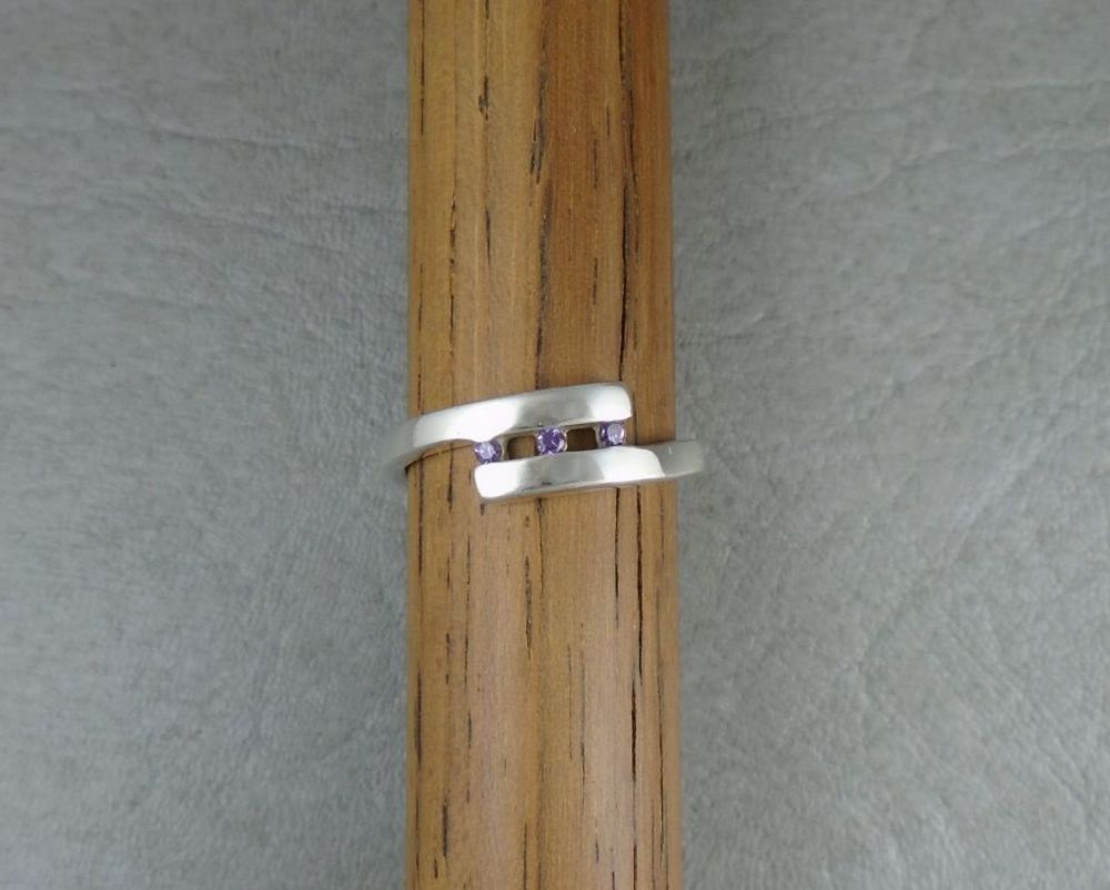 Sterling silver bypass ring with tiny purple stones