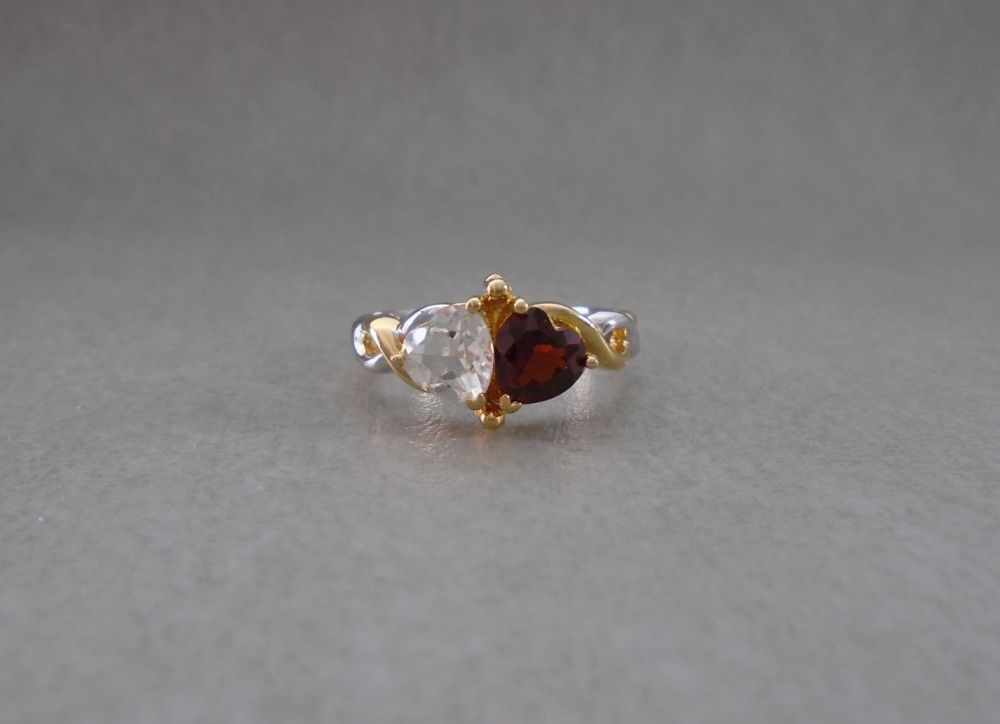 Sterling silver ring with two heart stones & gilt shoulder detail