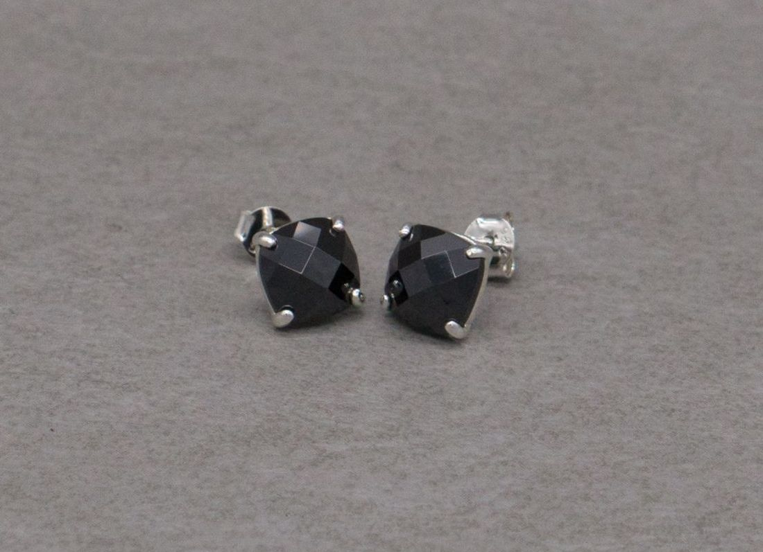 Sterling silver stud earrings with black faceted stones