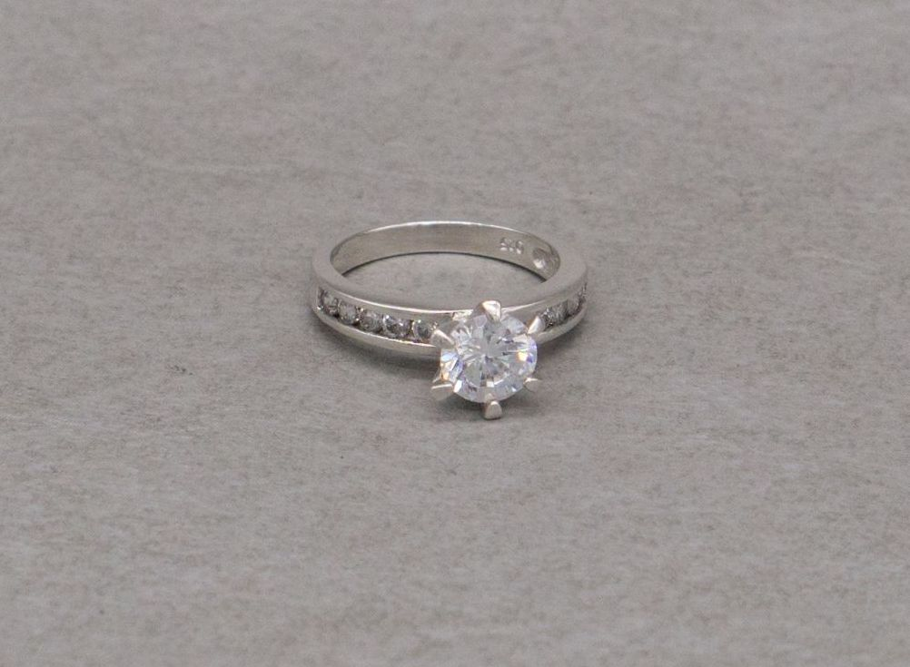Sterling silver proud set solitaire ring with accented shoulders