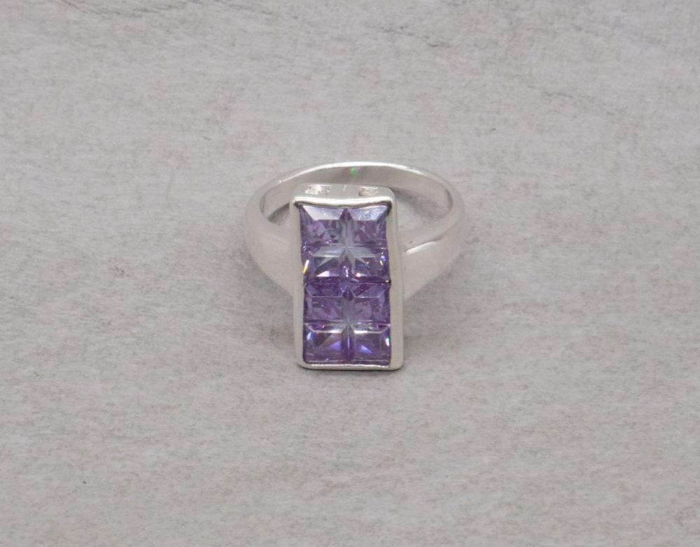 Wide sterling silver ring with 8 square amethyst glass stones