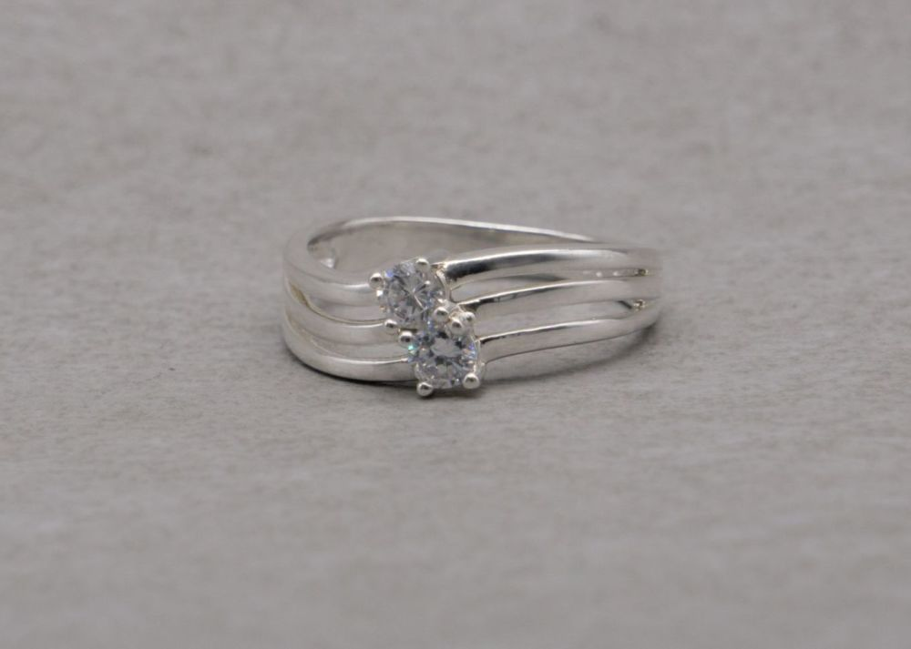 Sterling silver tri-band effect ring with two clear stones