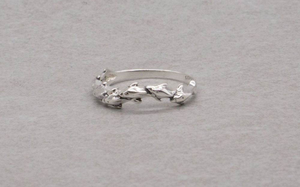 Sterling silver swimming dolphins ring