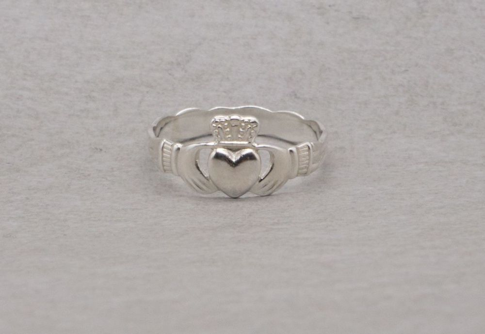 Sterling silver claddagh ring with a woven effect band