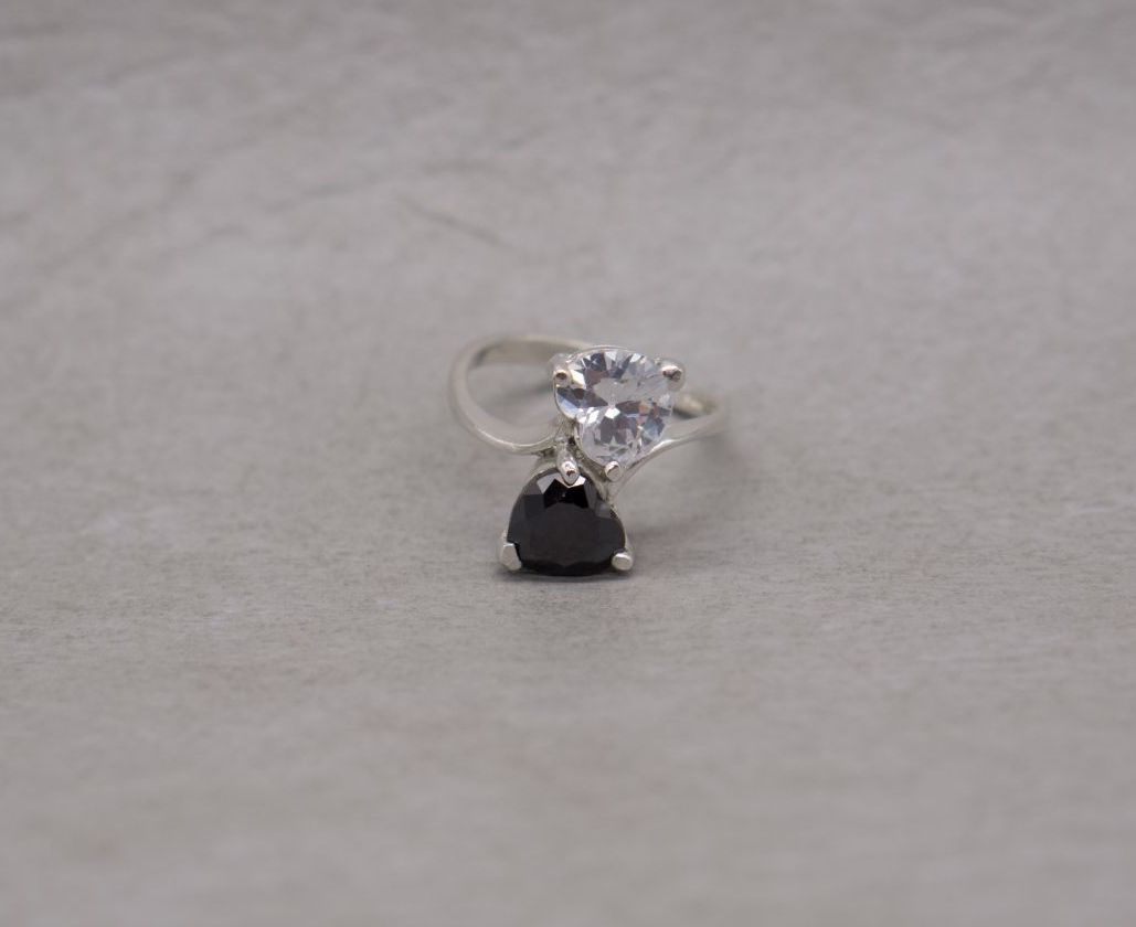 Sterling silver bypass ring with black & clear heart stones