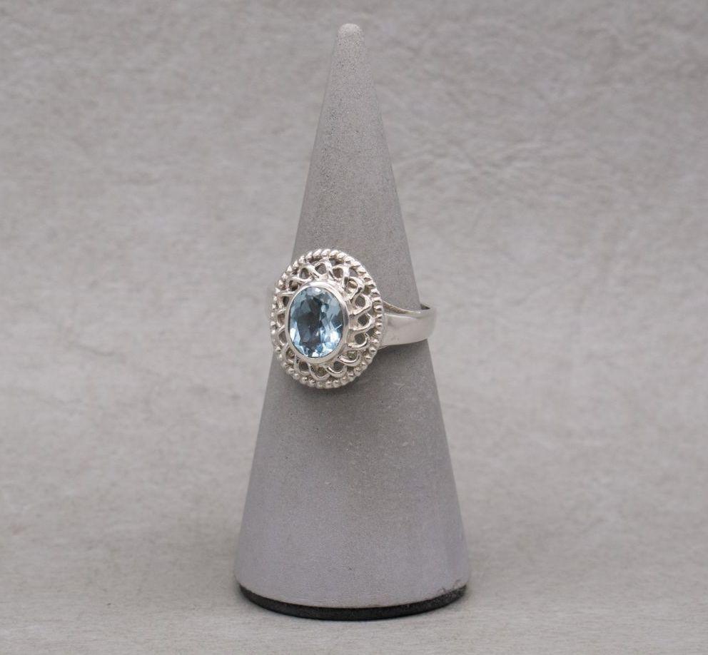 Elegant sterling silver & blue topaz cocktail ring