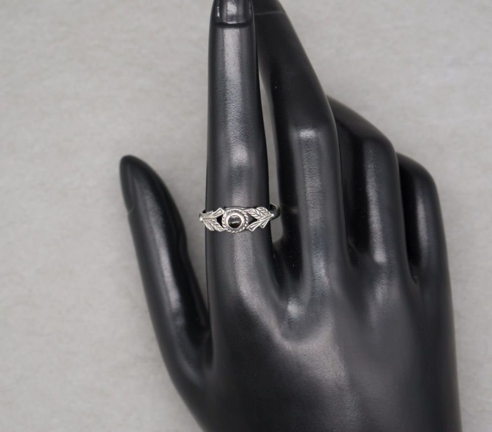 Sterling silver & black onyx ring with fancy leaf shoulders