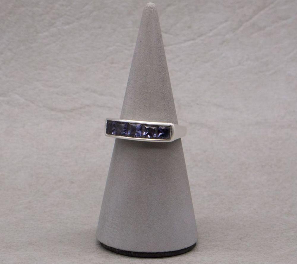 Sterling silver channel set amethyst ring, fancy mount