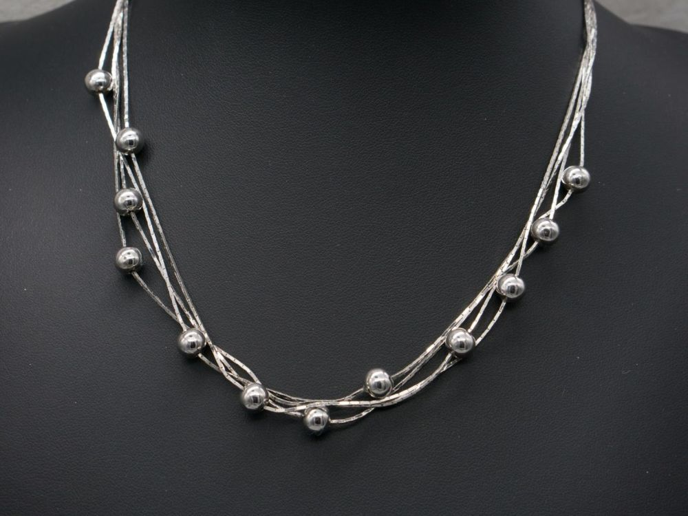 Multi-chain sterling silver necklace with bead balls
