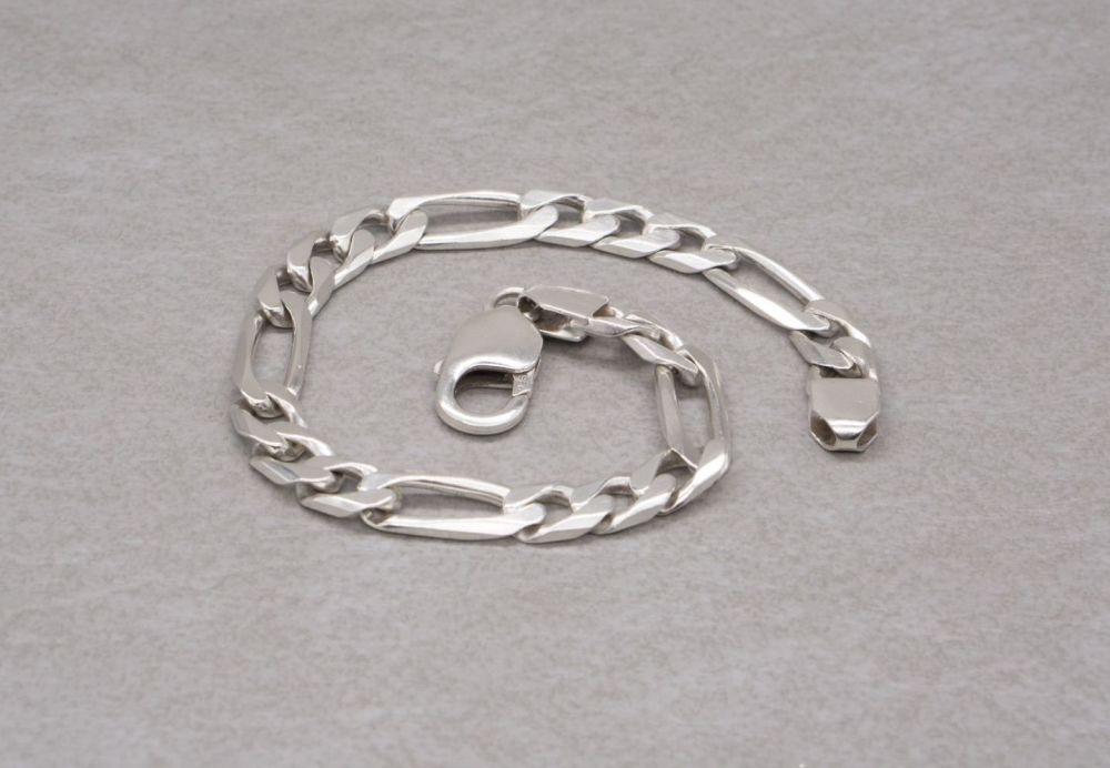 "Solid sterling silver Figaro chain bracelet (8.25"", 7mm)"
