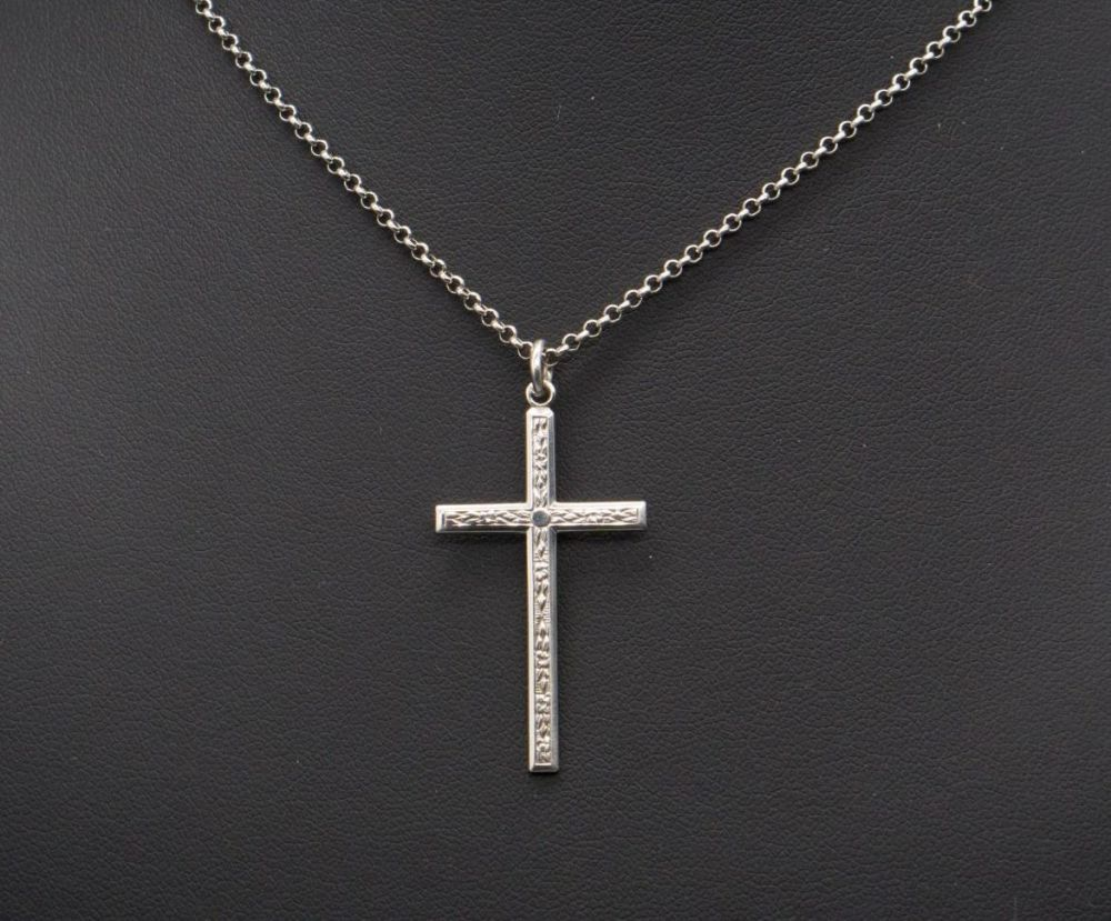 Vintage sterling silver necklace with a floral engraved cross