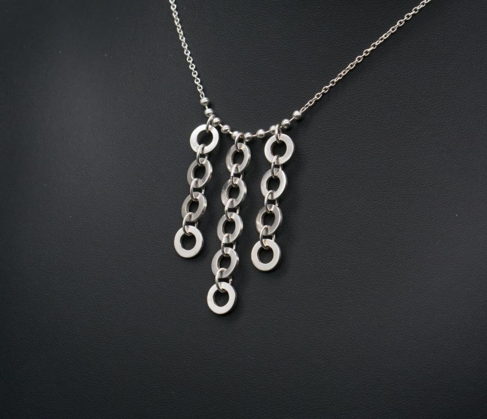 Sterling silver necklace with a disc fringe