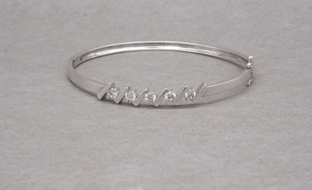 Sterling silver & clear stone bangle with safety