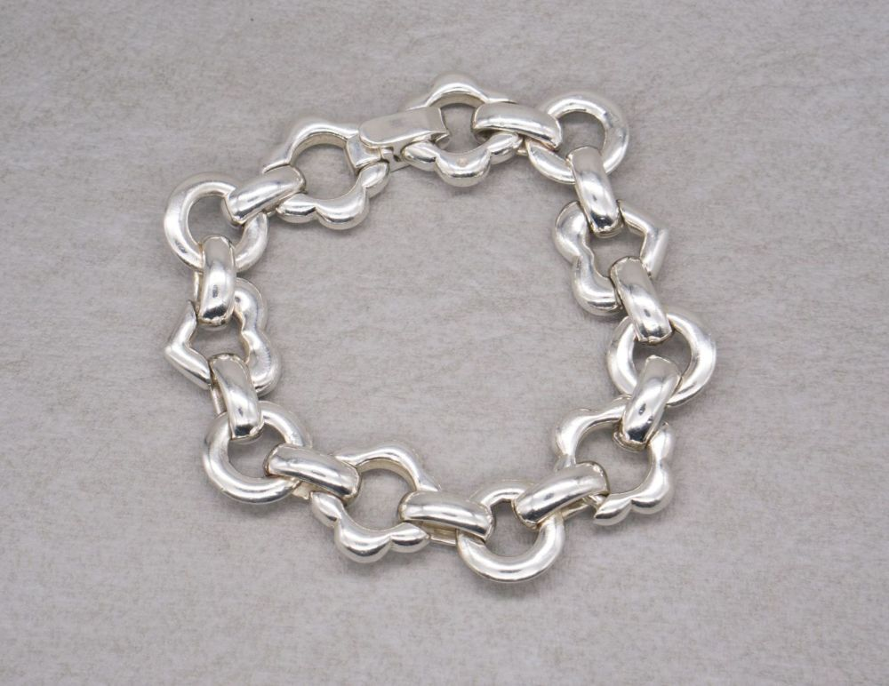 Heavy sterling silver hearts, flowers & circles bracelet