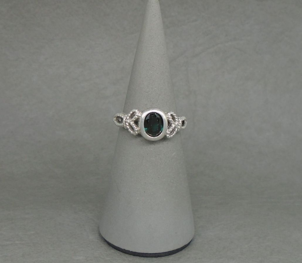 Sterling silver ring with a deep dark blue / green stone