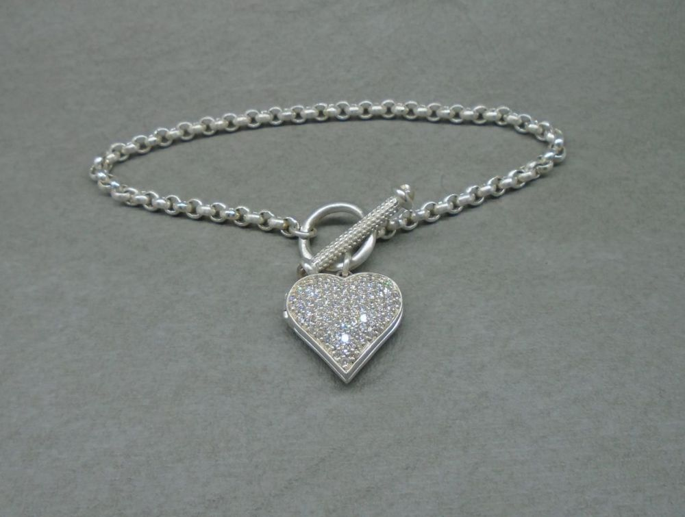 Sterling silver toggle bracelet with an encrusted heart locket charm