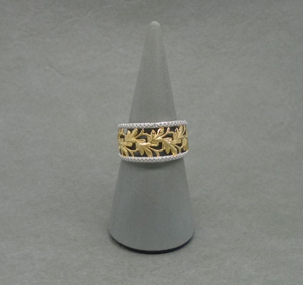 Wide fronted sterling silver ring with golden leaves