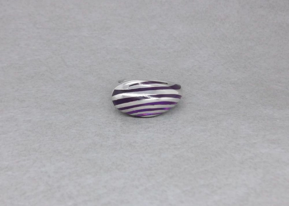 Unusual striped asymmetric ring with purple resin