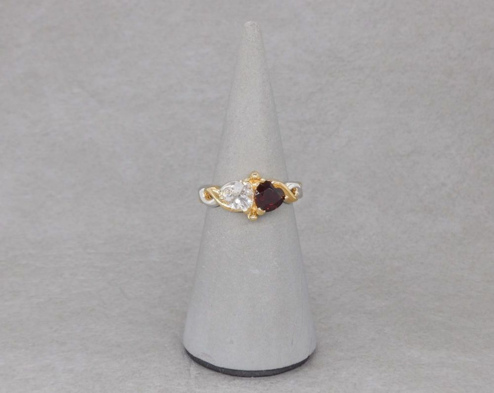 Sterling silver ring with red & clear heart stones, gilt shoulder detail