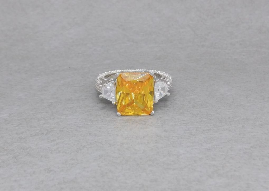 Sterling silver cocktail ring with yellow & clear stones