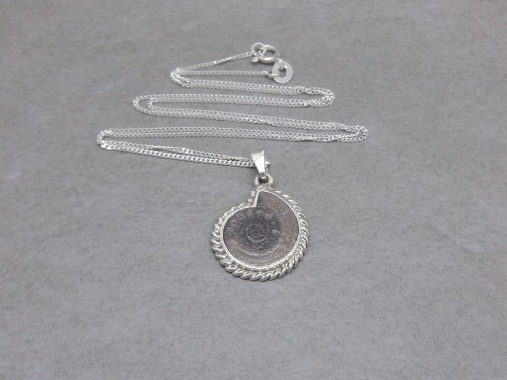 Sterling silver necklace with a small fossil pendant