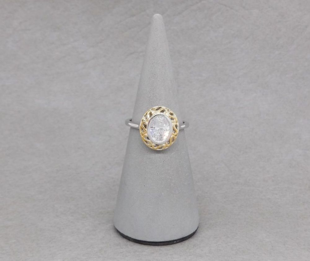 Sterling silver solitaire ring with gilt scroll frame