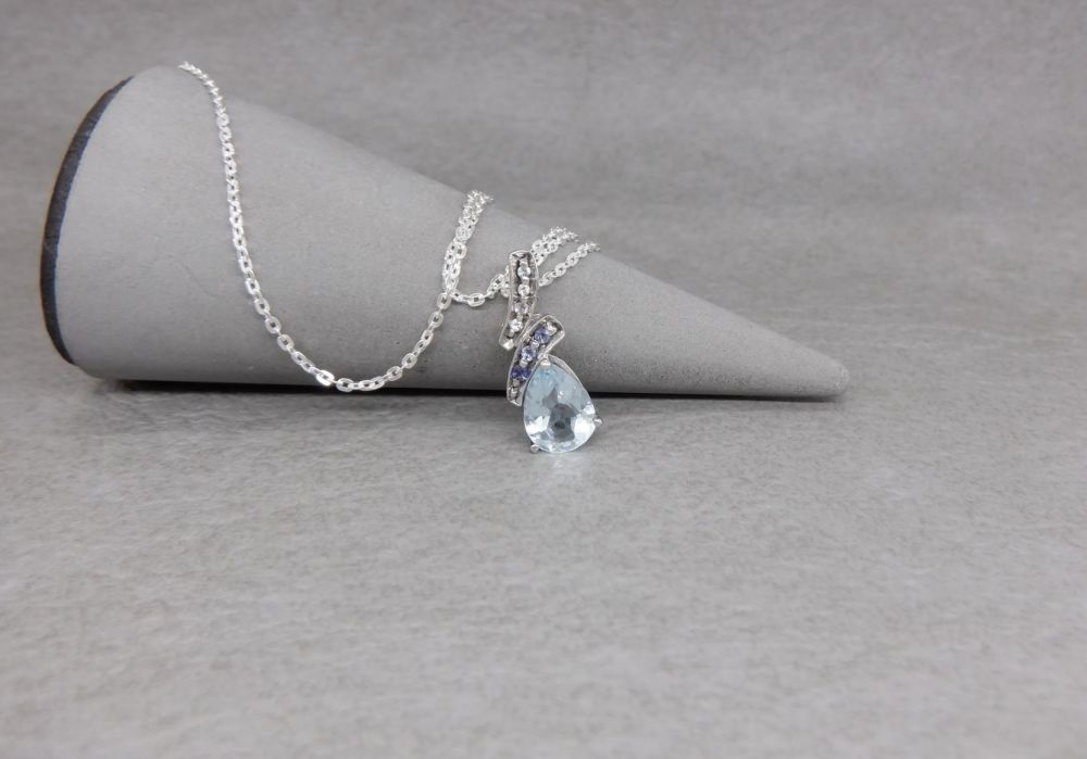 Sterling silver necklace with a small fancy stoned pendant