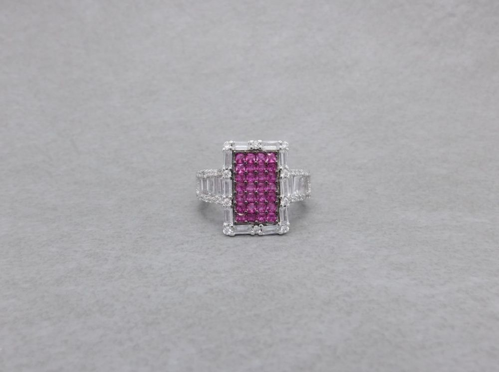 Unusual sterling silver ring with deep pink & clear stones