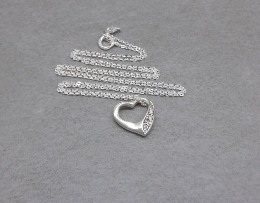 Small sterling silver stone set floating heart necklace