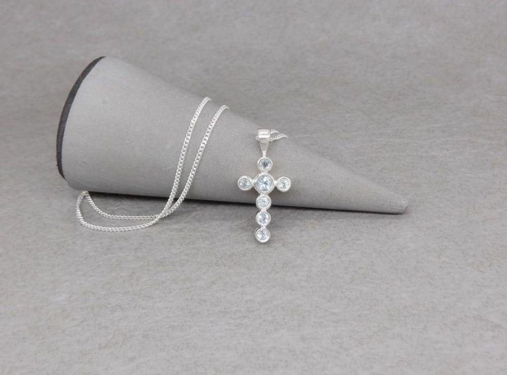 Small sterling silver & pale blue topaz cross necklace