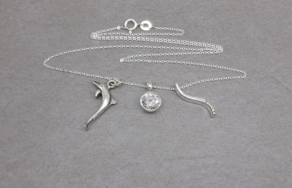 3 sterling silver pendants and a chain